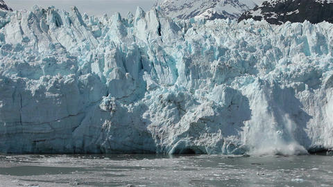 Ice tower calves off Margerie Glacier Glacier Bay Alaska HD 1406 Footage