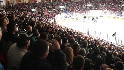 Fans at the stadium watching the game of hockey Footage