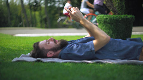 Man using mobile writing sms at the open air Footage