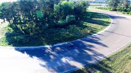 Motorcycle racing 4k aerial video. Moto riders turn circuit road track Footage
