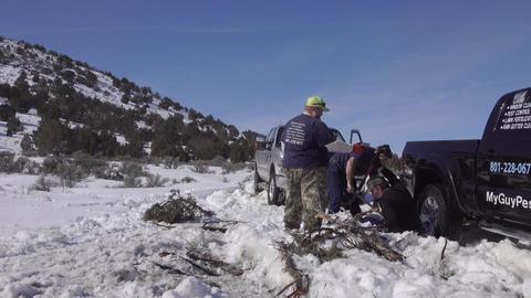 Men and truck stuck in winter snow 4K Footage