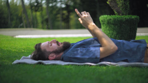 Man resting using smartphone at the open air Footage