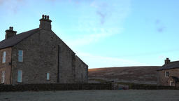 Northern England historic rock farm house sunrise pan 4K Footage