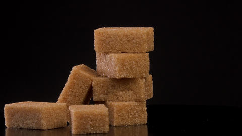 Cubes of brown sugar rotating on white background Live Action