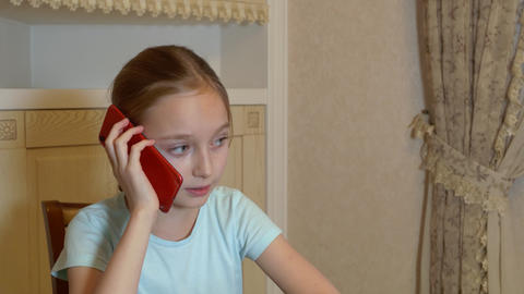Portrait serious girl teenager calling mobile phone in domestic interior. Face Live Action