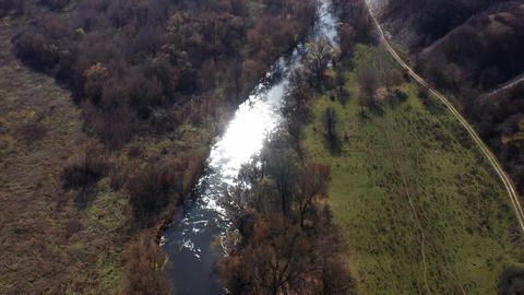 Aerial shot of the Oskol river and many trees in warm sunny weather in Live Action