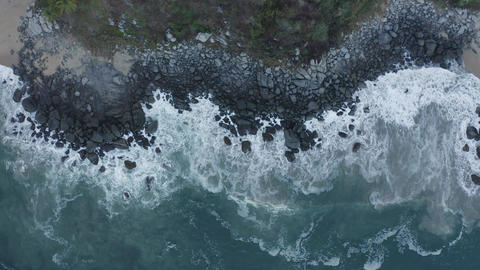 Top aerial shot of seashore with rocks Live Action
