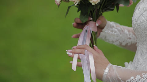 The bride holds a wedding bouquet. Happy wedding day Live Action