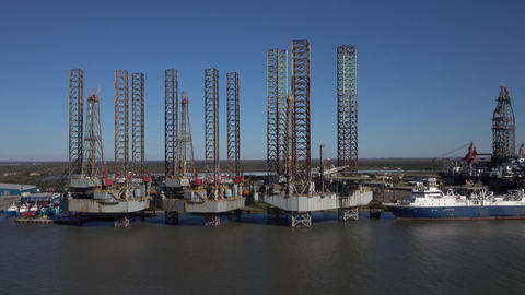 Oil platforms off shore ocean drilling rigs support ship 4K Footage