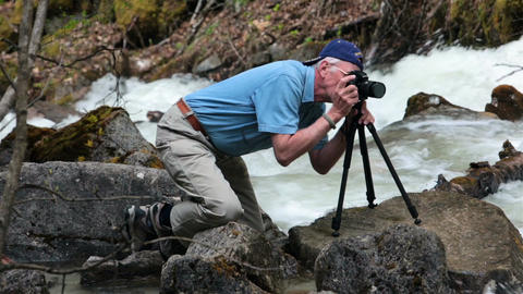 Photographer man by flooded river Alaska HD 7166 Footage