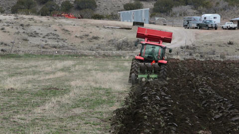 Plowing farm land by heavy duty tractor HD 2478 Footage