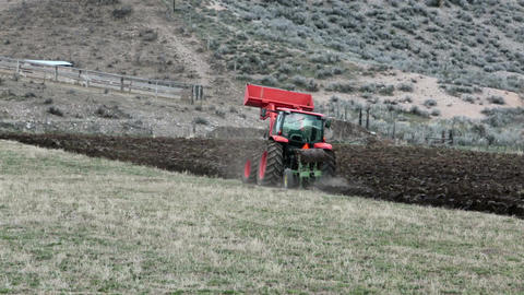 Plowing farm with heavy duty tractor hill HD 2458 Footage