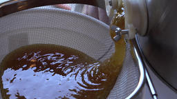 Processing fresh raw honey from home beehive 4K Footage