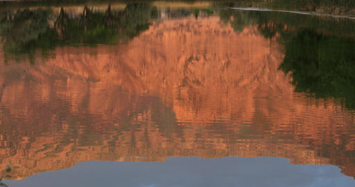 Reflection mountain on evening lake water DCI 4K Footage