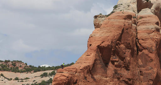 Rock climbers Moab Utah red rock mountains heat waves DCI 4K Footage
