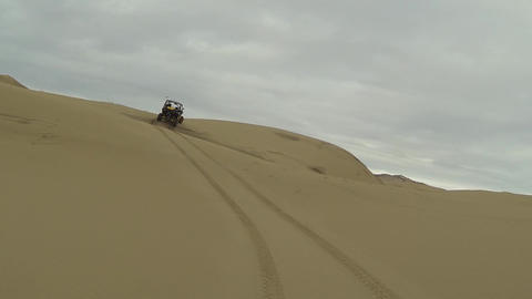 Sand dune POV recreation driving UTV sport vehicles HD Footage