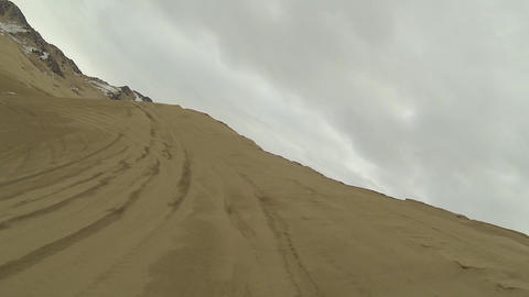 Sand dunes recreation climbing steep hill POV HD Footage