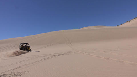 Sand dune recreation 4x4 ATV having fun 4K Live Action