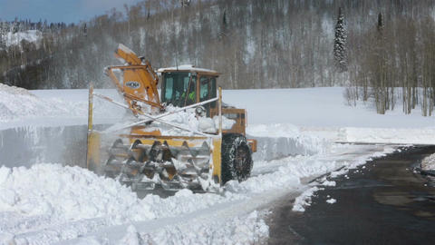Snowblower breaks clearing snow mountain road HD 2320 Footage
