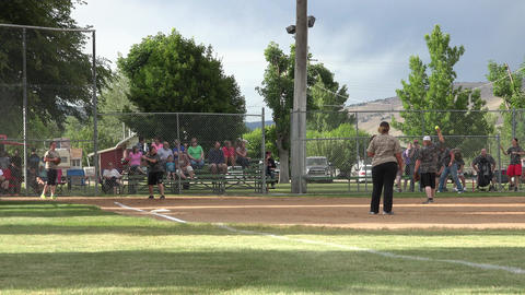Softball game rural community out at first 4K Footage