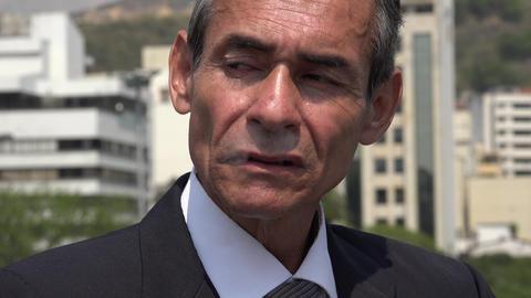 Hispanic Business Man Smoking A Cigarette Footage