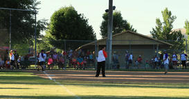 Softball rural community play ball DCI 4K Footage