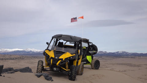 Sport 4x4 recreation ATV on top of sand mountain desert 4K Live Action