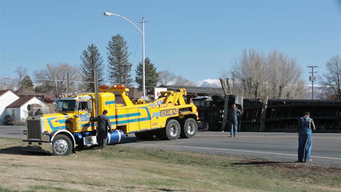 Tow truck at tractor trailer rollover accident HD 2433 Footage