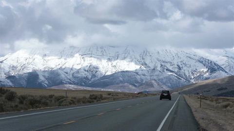 Traffic SUV drive mountain valley winter snow HD 2393 Footage
