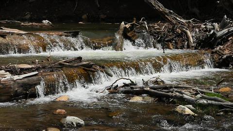 Ultra slow motion high mountain creek waterfall HD Footage