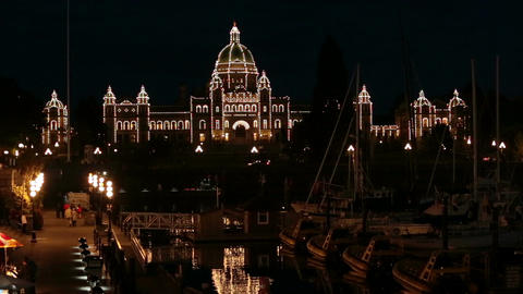 Victoria BC Canada Parliament Building night over marina HD 7940 Footage