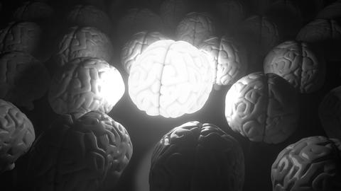 Glowing human brain among ordinary ones. Enlightenment, idea or inspiration Live Action