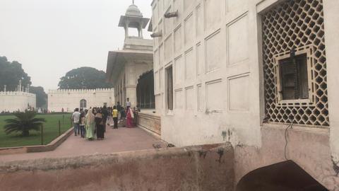 New Delhi, India, November 11, 2019, tourists walk along architectural buildings Live Action