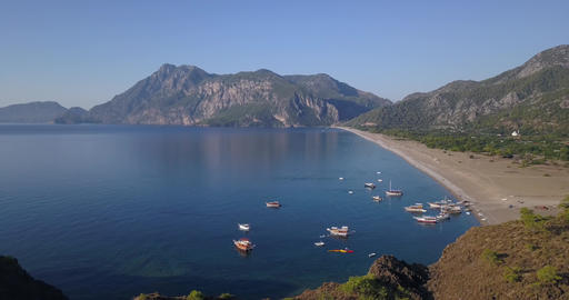 Many ships near the Cirali beach, scenic view on the mountains on the horizon Live Action