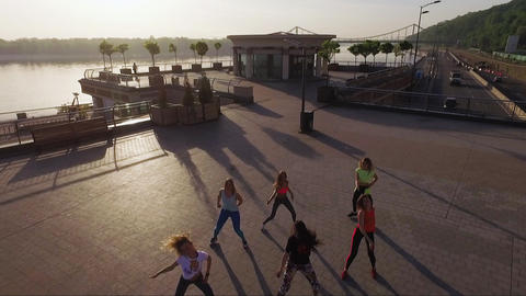 Sporty women dancing in city square swiping aerial shot Kyiv Ukraine Live Action