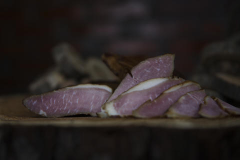 Prosciutto Served on a Rustic Wooden Surface. Smoked Cured Ham, Delicious, Domestic, Traditional Fotografía