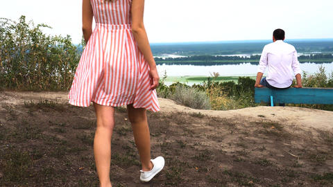 Love story. Beautiful couple walks on the banks of the Dnieper River Live Action