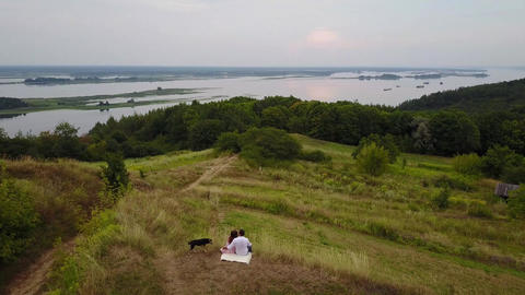 Aero Love story. Beautiful couple walks on the banks of the Dnieper River Live Action