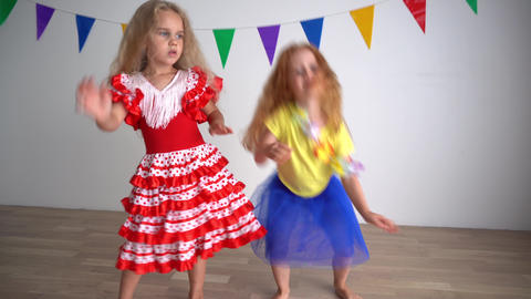 Music provokes happiness and makes you dance. Two little girls have fun Live Action