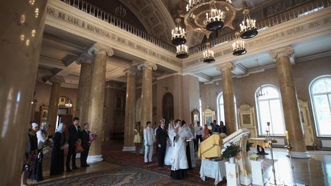 SAINT-PETERSBURG - JUL 25: Traditional orthodox church wedding Live Action
