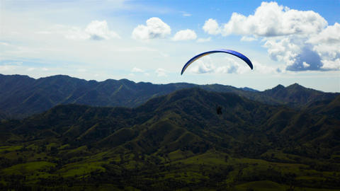 People riding and flying Paramotor flying in the sky mountains Live Action
