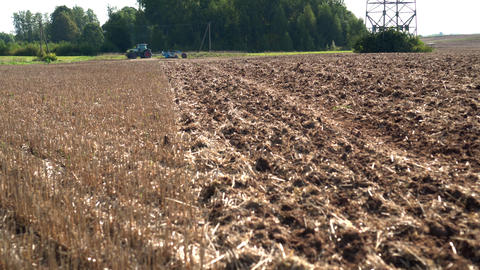 Tractor discing stubble field. Agricultural machine cultivating farm land soil Live Action