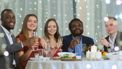 Corporate company at the table celebrates the new year Live Action