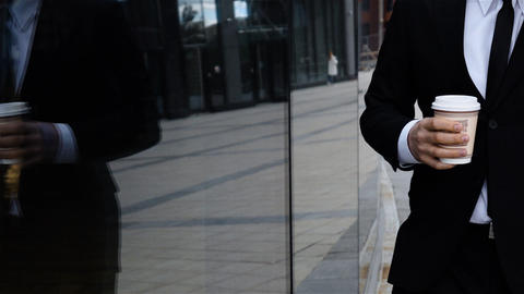 Businessman talking on mobile phone. Urban male drinking coffee outdoor Live Action