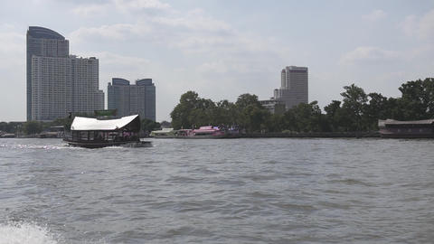 Traveling with public boat om CHAO PHRAYA river in Bangkok Live Action