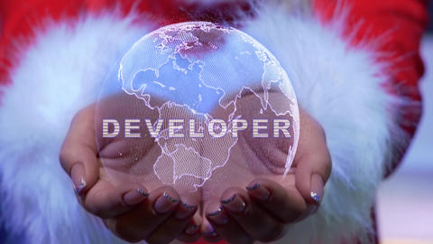 Hands holding planet with text Developer Live Action