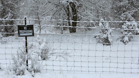 Winter farm fence snow storm no trespassing sign Footage