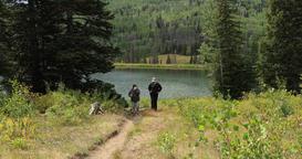 Women friends hiking mountain lake trail DCI 4K Footage