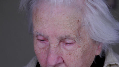 Close Up Of A 99 Years Woman Face While Reading, Old Age, Senescence Footage