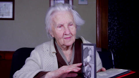 Very Old Woman Flipping Through Photo Album, Memories, Nostalgia Live Action